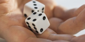 Dice in hand.Huffington Post