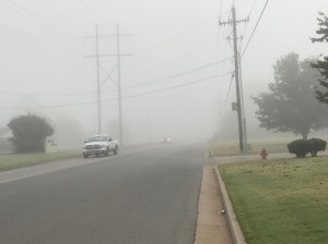 Fog and two trucks